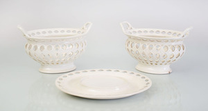 PAIR OF WEDGWOOD CREAMWARE RETICULATED CHESTNUT BASKETS AND A MATCHING STAND