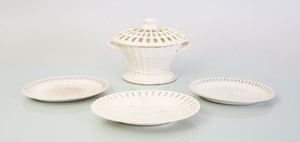 WEDGWOOD CREAMWARE TWO-HANDLED CHESTNUT BASKET AND COVER, A PAIR OF OVAL GRADUATED STANDS, AND A LARGER STAND