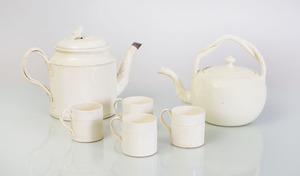 SIX CREAMWARE TEA ARTICLES