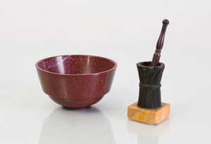 HARDSTONE BOWL AND A BRONZE WHEAT SHEATH-FORM MORTAR AND A ROSEWOOD PESTLE