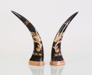 PAIR OF CARVED HORNS INSET WITH STRAW WORK EAGLES
