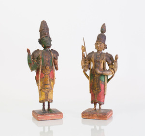 TWO INDIAN CARVED AND PAINTED WOOD FIGURES