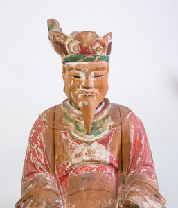 TWO CHINESE CARVED AND PAINTED WOOD SEATED FIGURES