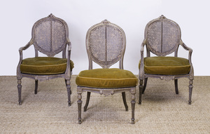 PAIR OF LOUIS XVI STYLE PAINTED AND CANED FAUTEUILS EN CABRIOLET AND A MATCHING CHAISE