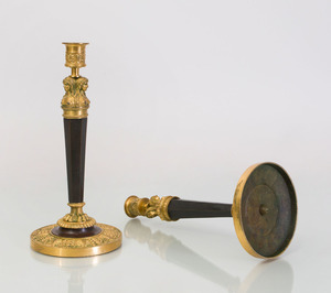 PAIR OF EMPIRE STYLE GILT AND PATINATED BRONZE CANDLESTICKS