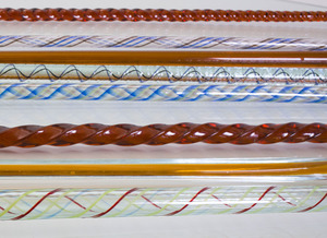 GROUP OF NINE AMBER AND INTERNALLY-DECORATED GLASS CANES
