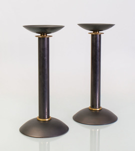 PAIR OF PATINATED AND GILT-BRONZE CANDLESTICKS, ATTRIBUTED TO KARL SPRINGER