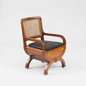 LATE REGENCY MAHOGANY AND CANED COMMODE CHAIR