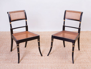 SET OF FOUR REGENCY EBONIZED, PARCEL-GILT AND CANED SIDE CHAIRS