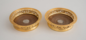 PAIR OF GEORGE IV SILVER-GILT BOTTLE COASTERS