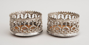 PAIR OF VICTORIAN GOTHIC REVIVAL SILVER-PLATED BOTTLE COASTERS