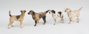Three Painted Cast-Iron Setters-On-the-Scent Door Stops, and a Painted Cast-Iron Terrier-Form Door Stop