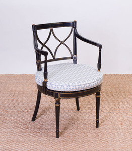 REGENCY STYLE EBONIZED PARCEL-GILT AND CANED ARMCHAIR