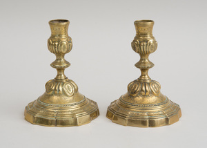 PAIR OF FLEMISH ENGRAVED BRASS CANDLESTICKS, IN THE RÉGENCE STYLE
