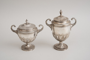 TWO SIMILAR GRADUATED SILVER URNS AND COVERS
