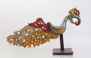 THAI POLYCHROME PAINTED WOOD FIGURE OF AN EXOTIC BIRD ON STAND