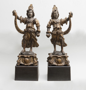 TWO CONTINENTAL CARVED GILTWOOD FIGURES OF SNAKE CHARMERS