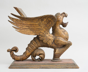 CONTINENTAL BAROQUE CARVED GILTWOOD WINGED GRIFFIN