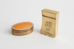 ENGLISH MONOGRAMMED BRASS SNUFF BOX AND AN ENAMEL-LIDDED BRASS OVAL BOX