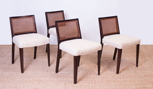 SET OF FOUR DUNBAR STYLE STAINED WOOD AND CANED SIDE CHAIRS