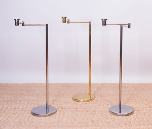PAIR OF NESSEN CHROME SWING-ARM FLOOR LAMPS AND A NESSEN BRASS SWING-ARM FLOOR LAMP