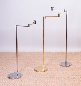 PAIR OF NESSEN CHROME SWING-ARM FLOOR LAMPS AND A NESSEN BRASS SWING-ARM FLOOR LAMP