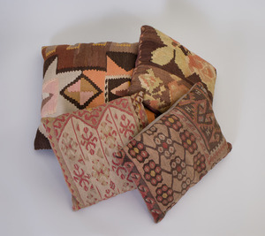 GROUP OF FOUR CARPET FRAGMENT PILLOWS
