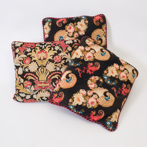 Three Needlework Pillows with Floral Design and Braided Edges