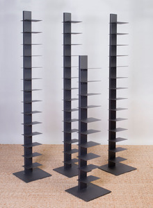 SET OF THREE COATED-METAL BOOKSHELVES AND A SMALLER MATCHING BOOKSHELF