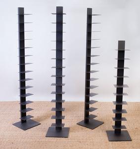 SET OF THREE COATED-METAL BOOKSHELVES AND A SMALLER MATCHING BOOKSHELF