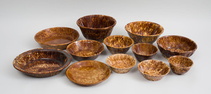 Group of Nine Tortoiseshell Glazed Pottery Bowls, an Oval Basin, and Two Pans