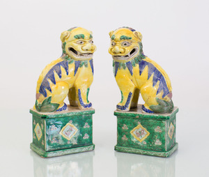 PAIR OF CHINESE YELLOW, GREEN AND BLUE GLAZED BUDDHISTIC LIONS