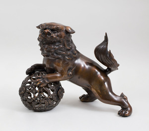 LARGE JAPANESE GILT-BRONZE BUDDHISTIC LION WITH BALL