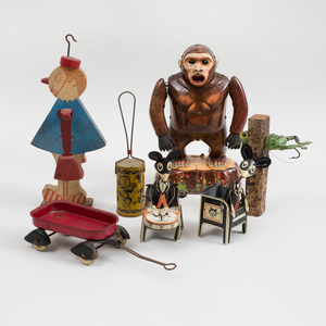 Group of Five Tin Toys and Two other Toys