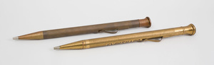 Two Brass-Plated Pen Display Models