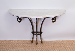 FRENCH ART DECO IRON AND PARCEL-GILT CONSOLE WITH HOOVED FEET