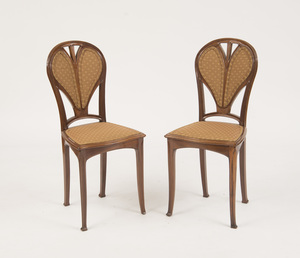 PAIR OF ART NOUVEAU CARVED MAHOGANY SIDE CHAIRS, IN THE STYLE OF LOUIS MAJORELLE