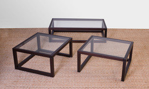SET OF THREE STAINED WOOD AND GLASS-INSET LOW TABLES, OF RECENT MANUFACTURE