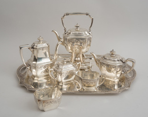 TIFFANY & CO. CRESTED SILVER SIX-PIECE TEA AND COFFEE SERVICE AND A MATCHING CRESTED SILVER TRAY