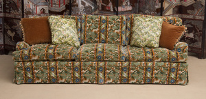 UPHOLSTERED THREE-SEAT FLORAL SKIRTED SOFA