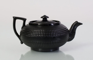 ENGLISH BLACK-GLAZED PORCELAIN CANE-WARE TEAPOT AND COVER