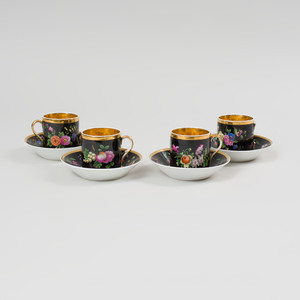 Four Popov Black Ground Porcelain Cups and Saucers