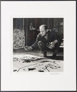 MARTHA HOLMES (1923-2006): JACKSON POLLOCK WORKING IN HIS BARN STUDIO, SPRINGS, NEW YORK