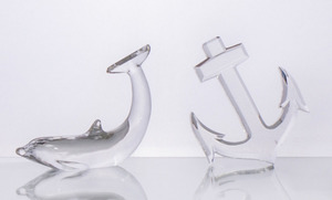 BACCARAT GLASS DOLPHIN-FORM PAPERWEIGHT AND A BACCARAT GLASS ANCHOR-FORM PAPERWEIGHT