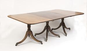 REGENCY STYLE MAHOGANY TRIPLE-PEDESTAL DINING TABLE