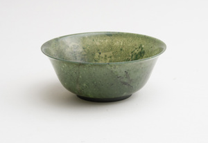 CHINESE CARVED SPINACH GREEN JADE FOOTED BELL-FORM BOWL