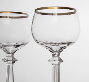 Set of Four Gilt Decorated Colorless Wine Glasses