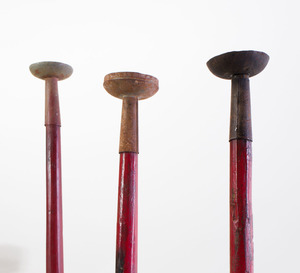 SET OF THREE CHINESE RED PAINTED AND METAL HAT STANDS