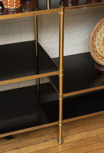 BRASS AND BLACK LACQUER SIX-TIER ETAGERE, STYLE OF BILLY BALDWIN
