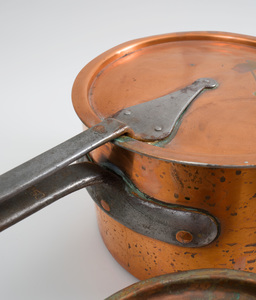 Two Large Copper Sauce Pans, with Steel Handles and Covers and a Nest of Five Small Copper Sauce Pans with Brass Handles